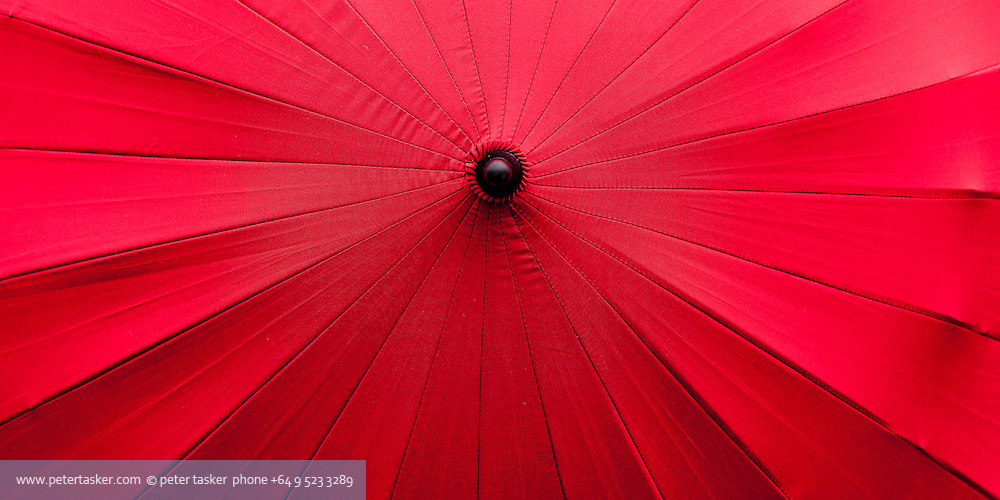 Close up view of vividly coloured umbrellas, photographed in Japan.