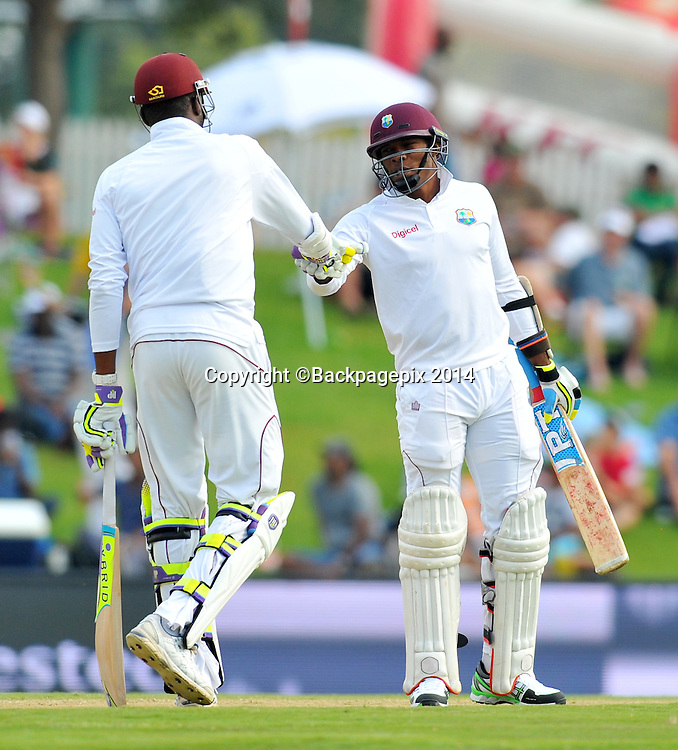 Sulieman Benn and Sheldon Shane Cottrell of the West Indies during the 2014 Sunfoil 1st Test match between South Africa and West Indies at the Supersport Park in Pretoria, South Africa on December 19, 2014 ©Samuel Shivambu/BackpagePix