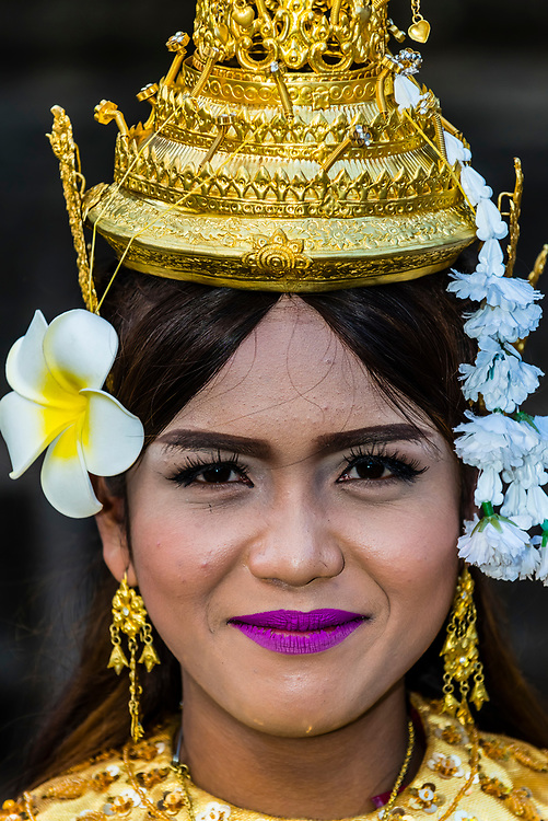 Performers in Khmer costume, Angkor Wat,  the largest religious monument in the world (means City which is a Temple); Cambodia.