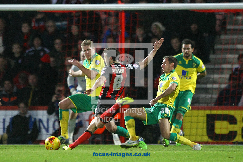 Gary O&rsquo;Neil of Norwich and Michael Turner of Norwich combine to block a shot by Harry Arter of Bournemouth during the match at the Goldsands Stadium, Bournemouth<br /> Picture by Paul Chesterton/Focus Images Ltd +44 7904 640267<br /> 10/01/2015