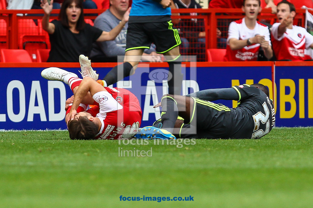 Rhoys Wiggins of Charlton Athletic is fouled by Albert Adomah of Middlesbrough who is subsequently sent off for the challenge during the Sky Bet Championship match at The Valley, London<br /> Picture by David Horn/Focus Images Ltd +44 7545 970036<br /> 27/09/2014