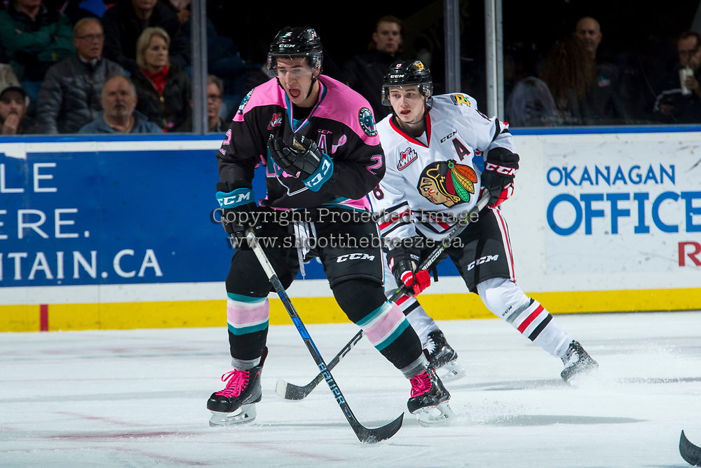 KELOWNA, CANADA - OCTOBER 21: James Hilsendager #2 of the Kelowna Rockets is back checked by Cody Glass #8 of the Portland Winterhawks on October 21, 2017 at Prospera Place in Kelowna, British Columbia, Canada.  (Photo by Marissa Baecker/Shoot the Breeze)  *** Local Caption ***