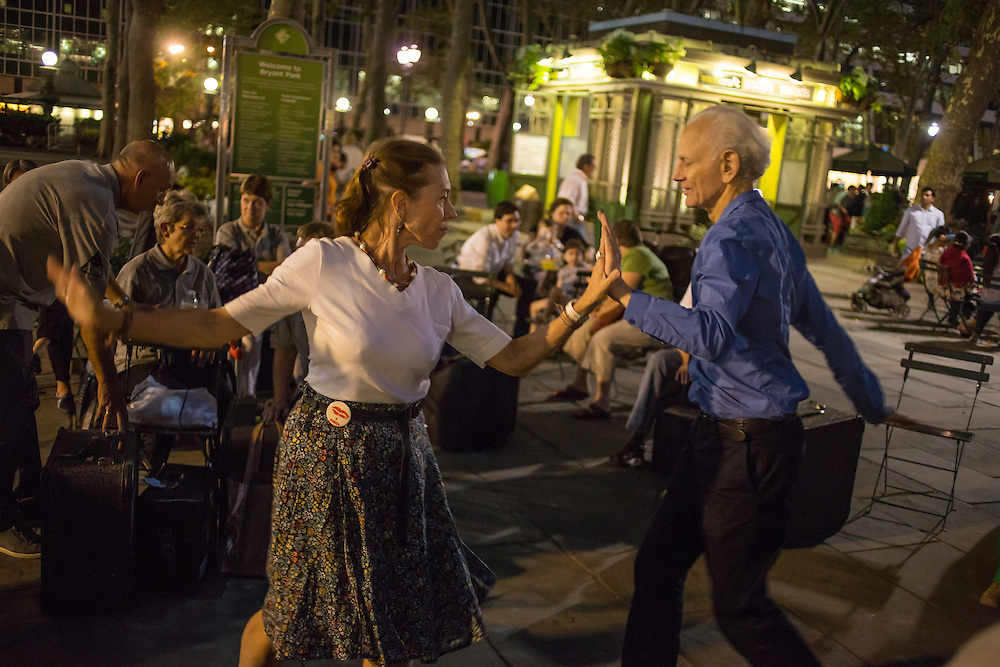 A couple dances to the music of The Old Aker Band (Gamle Aker Spelemannslag), a Norwegian accordion band, at Accordions Around the World in Bryant Park.