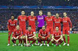 LIVERPOOL, ENGLAND - Tuesday, December 9, 2014: Liverpool's players line up for a team group photograph before the final UEFA Champions League Group B match at Anfield. Back row L-R: Raheem Sterling, Dejan Lovren, Martin Skrtel, goalkeeper Simon Mignolet, Rickie Lambert, Jose Enrique, Jordan Henderson Front row L-R: Lucas Leiva, captain Steven Gerrard, Glen Johnson, Joe Allen. (Pic by David Rawcliffe/Propaganda)