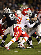 Kansas City Chiefs outside linebacker Tamba Hali (91) rushes during the NFL week 12 regular season football game against the Oakland Raiders on Thursday, Nov. 20, 2014 in Oakland, Calif. The Raiders won their first game of the season 24-20. ©Paul Anthony Spinelli