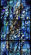 People in prayer, from the Tree of Jesse stained glass window, 1974, by Marc Chagall, 1887-1985, with the studio of Jacques Simon, in the axial chapel of the apse of the Cathedrale Notre-Dame de Reims or Reims Cathedral, Reims, Champagne-Ardenne, France. The cathedral was built 1211-75 in French Gothic style with work continuing into the 14th century, and was listed as a UNESCO World Heritage Site in 1991. Picture by Manuel Cohen