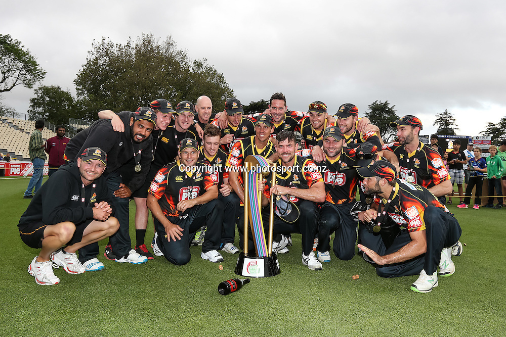 The Wellington Firebirds team photo after winning the Deorgie Pie Super Smash T20 cricket Final - Firebirds v Aces at Seddon Park, Hamilton, New Zealand on Sunday 7 December 2014.  Photo: Bruce Lim / www.photosport.co.nz