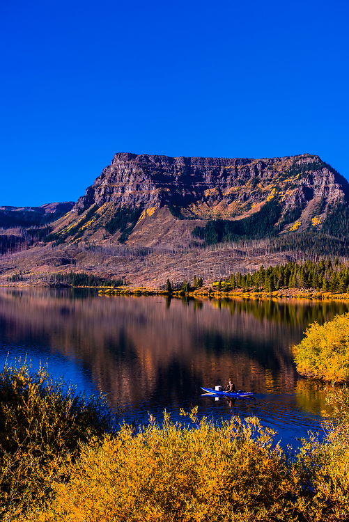 Fly fishing from an inflattable kayak, Trappers Lake, Flat Tops Wilderness, Colorado USA.