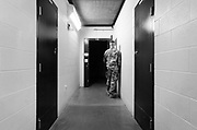 A military guard at the prison camp at Guantanamo, Cuba, Jan 28 2017, guards a door to an entrance to a cell block.<br /> The guards turn away their faces so you cannot identify them. It is standard operation procedure when pictures are made. When you work as a journalist at the Guantanamo you work under military censorship and all your material is checked every day and approved for publication.<br /> The prison camp on the Guant&aacute;namo naval base was the creation of President George W. Bush. The prison camp was considered an important part of the US war on terrorism. Over the years, 779 people have been brought to the camp. 41 people are still detained. Of them, 26 people count as &quot;forever prisoners&rdquo;, indefinite detainees under the Law of War. Two prisoners have been in the camp since it was opened in January 2002. The last prisoner taken to the camp came in March 2008. The so-called war on Terror and the Guantanamo prison camp have been heavily criticized for violation of human rights regarding torture and habeas corpus.<br /> It is unclear what US President Donald Trump wants to do with the camp, but during the election campaign he said that he would fill Guant&aacute;namo Bay with &quot;bad dudes&quot;. Photo by Ola Torkelsson<br />