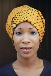 Portrait of woman wearing colourful head scarf,