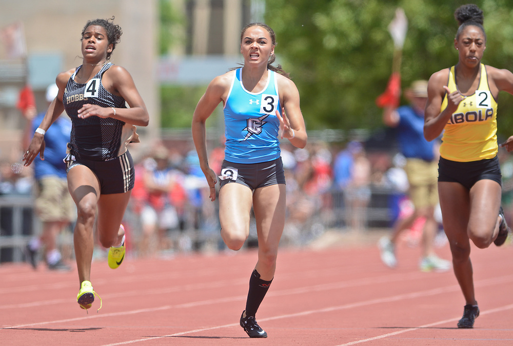 mkb051317m/sports/Marla Brose --  Cleveland's Aphiniti Crupper, center, races against Cibola's #2 Hannah Thompson, right, and Hobbs' Amaya Lewis, left, during Crupper's 6A victory in the 100 meter dash during the final day of the NMAA State Track & Field Championships, Saturday, May 13, 2017, in Albuquerque, N.M.  (Marla Brose/Albuquerque Journal)