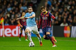 Barcelona Defender Gerard Pique (ESP) is challenged by Man City Forward Alvaro Negredo (ESP) - Photo mandatory by-line: Rogan Thomson/JMP - Tel: 07966 386802 - 18/02/2014 - SPORT - FOOTBALL - Etihad Stadium, Manchester - Manchester City v Barcelona - UEFA Champions League, Round of 16, First leg.