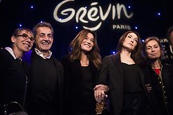 French-Italian singer Carla Bruni-Sarkozy poses with her husband former French President Nicolas Sarkozy before the inauguration of Bruni's wax sculpture on December 17, 2018 at the Musee Grevin wax museum in Paris. Photo by ABACAPRESS.COM