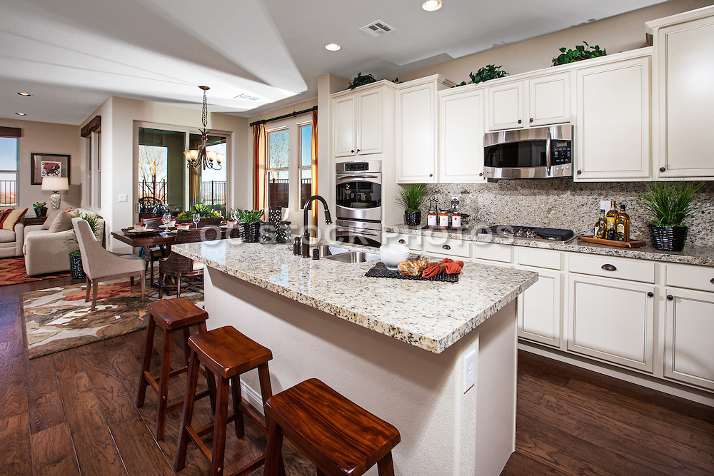 Kitchen with White Cabinets and Dark Hardwood Floors