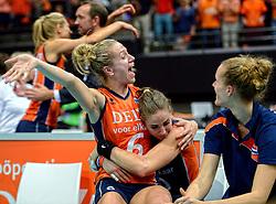 03-10-2015 NED: Volleyball European Championship Semi Final Nederland - Turkije, Rotterdam<br /> Nederland verslaat Turkije in de halve finale met ruime cijfers 3-0 / Myrthe Schoot #9 kan het niet geloven dat ze in de finale staat en huilt maar Maret Balkestein-Grothues #6 vrolijkt haar op