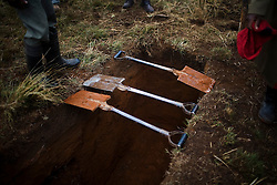 Community members dig a grave before the funeral of Sindiswa Sakubona, who died with TB. Her husband, a former mine worker, also passed away from TB in 2001.  The couple leaves behind 7 orphaned children. TB is common among ex-miners in Eastern Cape.  Once a miner has contracted TB the disease can lie in wait for more than 10 years until the patients immune system is weakened and the disease becomes active.  South African Gold miners are particularly vulnerable to contracting TB because of the small, poorly ventilated work conditions, high rates of TB and high rates of silicosis, a lung disease often found in miners that increases the chance of catching TB.