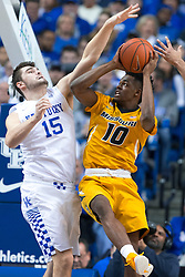 Kentucky forward Isaac Humphries, left, and guard Jamal Murray contest a shot by Missouri guard K.J. Walton in the second half. <br /> <br /> The University of Kentucky hosted the University of Missouri, Wednesday, Jan. 27, 2016 at Rupp Arena in Lexington.
