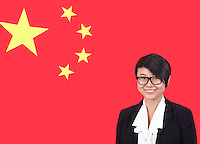Portrait of young businesswoman smiling over Chinese flag