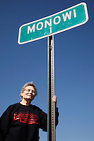 Elsie Eiler poses with the town population sign outside of the village of Monowi, Nebraska April 28, 2011. Eiler is the person living in Monowi making it the only incorporated town, village or city in the United States with only one resident.  REUTERS/Rick Wilking (UNITED STATES)
