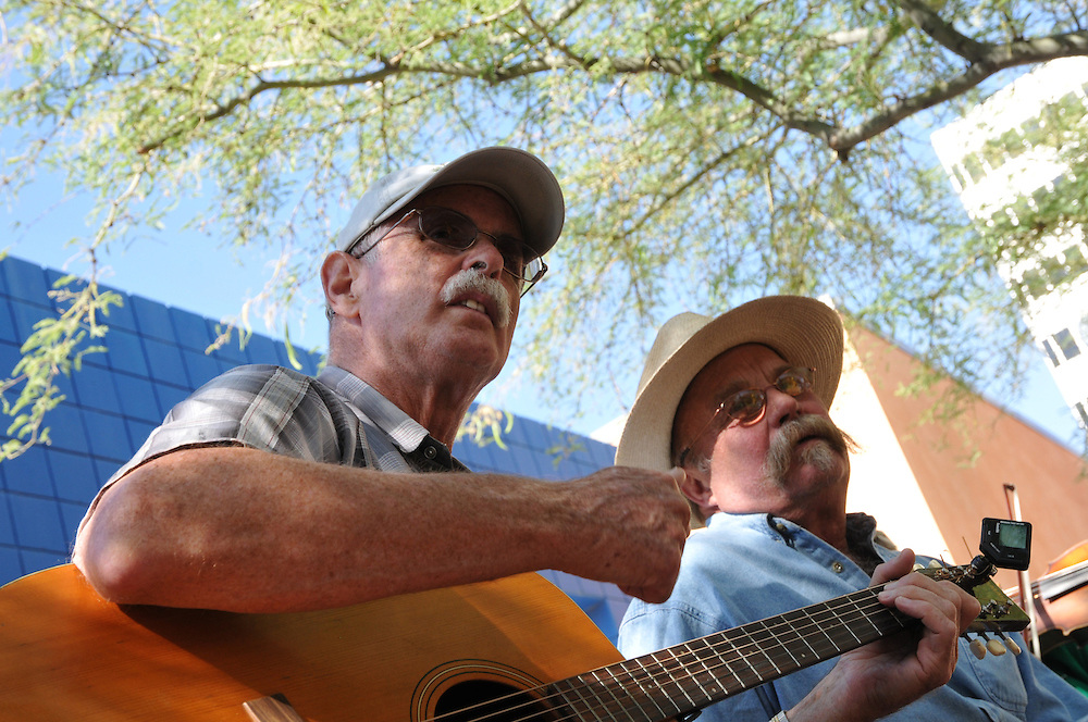 Members of Manzanita Bluegrass jam outside the Tucson Museum of Art during the 2011 Tucson Folk Festival. Event photography by Martha Retallick.