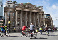 Riders pass Mansion House as part of the Prudential RideLondon FreeCycle 29/07/2017.<br />
