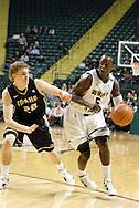 Vandal freshman Matt Borton (20) guards Raider junior John Balwigaire (5) in the second half as the Idaho Vandals play the Wright State University Raiders at the Nutter Center, Tuesday, December 20, 2011.