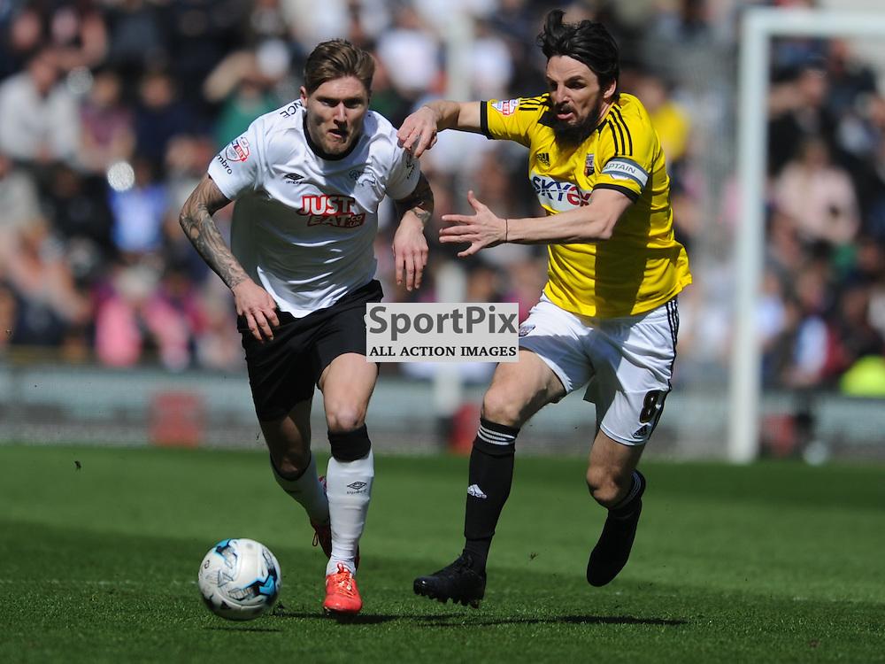 Brentfords Jonathan Douglas chases Derbys Jeff Hendrick, Derby County  v Brentord, Sky Bet Championship, IPro Stadium Saturday 11th April 2015
