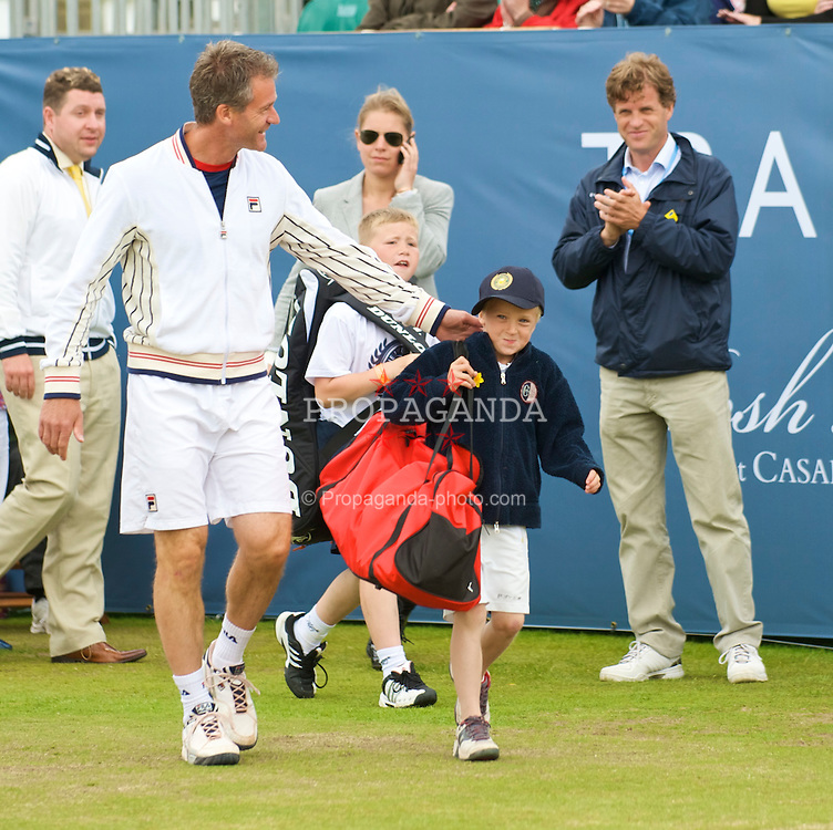 LIVERPOOL, ENGLAND - Saturday, June 20, 2009: Young Felix Borg walks out with Anders Jarryd (SWE) on Day Four of the Tradition ICAP Liverpool International Tennis Tournament 2009 at Calderstones Park. (Pic by David Rawcliffe/Propaganda)
