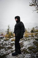 Portrait of a woman in the upper Enchantments during a snow storm, Enchantment Lakes Wilderness Area, Washington Cascades, USA.