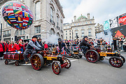 Miniature Steamers for Charity - The New Years Day parade passes through central London.