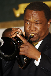 DURBAN - 26 July 2007 - Brian Thusi, deputy manager of  KwaZulu-Natal arts development, plays the trumpet at  an evening of music and presentations hosted by the Arts & Culture department as a part of a two-day conference for artists..He is the husband of the KwaZulu-Natal Tourism, Arts and Culture MEC Weziwe Thusi..Picture: Giordano Stolley/Allied Picture Press
