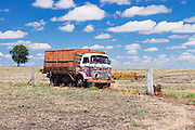 old commer farm truck in harvested field under cumuluas cloud near Emu Vale, Queensland, Australia <br />