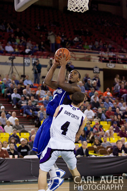 November 27th, 2010:  Anchorage, Alaska - Drake Bulldog Rayvonte Rice (24) draws a foul as he elevates for a lay up in the Bulldog 81-82 loss to Weber State in the third place game of the Great Alaska Shootout.