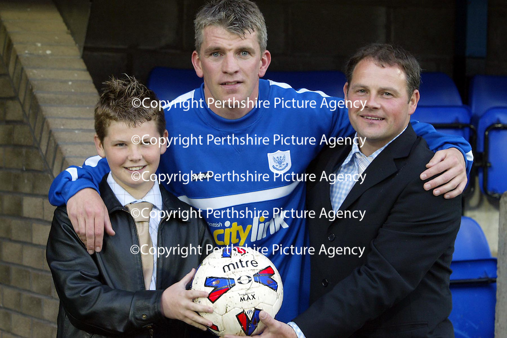 St Johnstone v Newcastle Utd Jim Weir Testimonial..08.05.04  <br />Derek Flemming and son match ball sponsors<br /><br />Picture by Graeme Hart.<br />Copyright Perthshire Picture Agency<br />Tel: 01738 623350  Mobile: 07990 594431