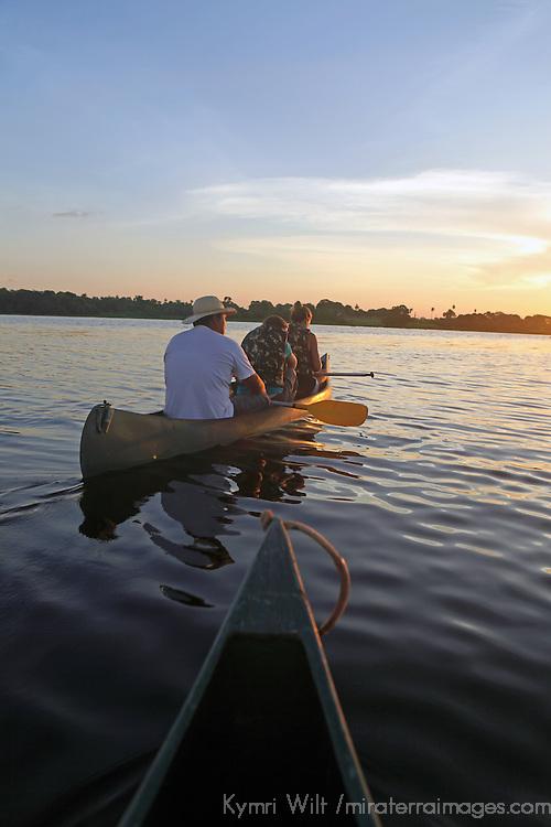 South America, Brazil, Pantanal. watching the sunset by canoe.