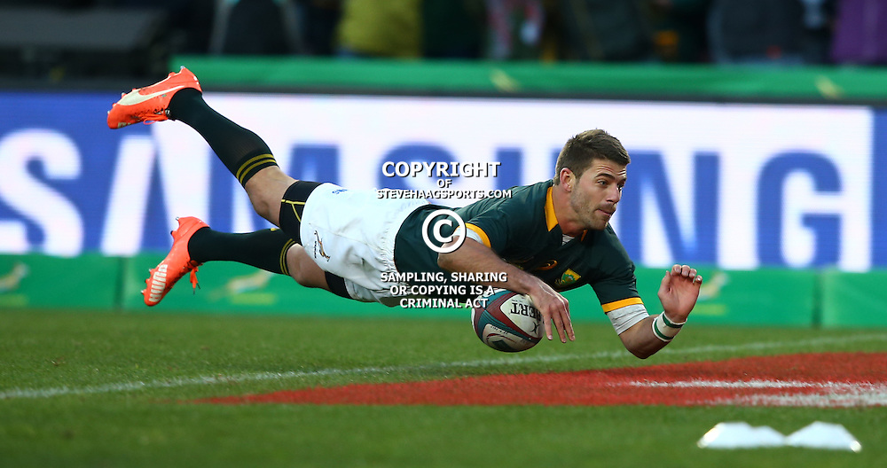 JOHANNESBURG, SOUTH AFRICA - JULY 25: Willie le Roux of South Africa going over for a try during The Castle Lager Rugby Championship 2015 match between South Africa and New Zealand at Emirates Airline Park on July 25, 2015 in Johannesburg, South Africa. (Photo by Steve Haag/Gallo Images)