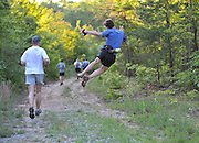 Denis Cook, from Bethesda, MD, leaps into the air and clicks his heels during the  Massanutten Mountain Trails 100 Mile run (MMT 100) May 17, 2008..The  race is considered one of the toughest Ultra Marathons on the east coast. The  Massanutten Mountain Trails 100 Mile run (MMT 100) May 17, 2008.<br /> The  race is considered one of the toughest Ultra Marathons on the east coast.