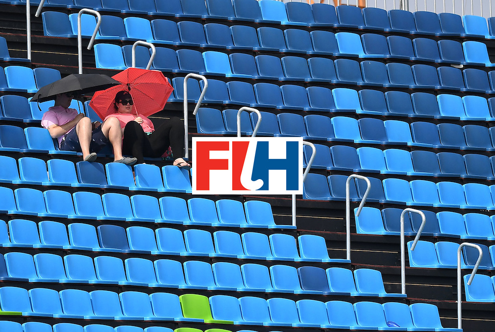 Two spectators sit in the stands during the men's field hockey Germany vs Ireland match of the Rio 2016 Olympics Games at the Olympic Hockey Centre in Rio de Janeiro on August, 9 2016. / AFP / MANAN VATSYAYANA        (Photo credit should read MANAN VATSYAYANA/AFP/Getty Images)
