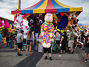 14 AUGUST 2019 - DES MOINES, IOWA: A fair goer carries with a large plush toy he won at the Iowa State Fair. The Iowa State Fair is one of the largest state fairs in the U.S. More than one million people usually visit the fair during its ten day run. The 2019 fair run from August 8 to 18.               PHOTO BY JACK KURTZ