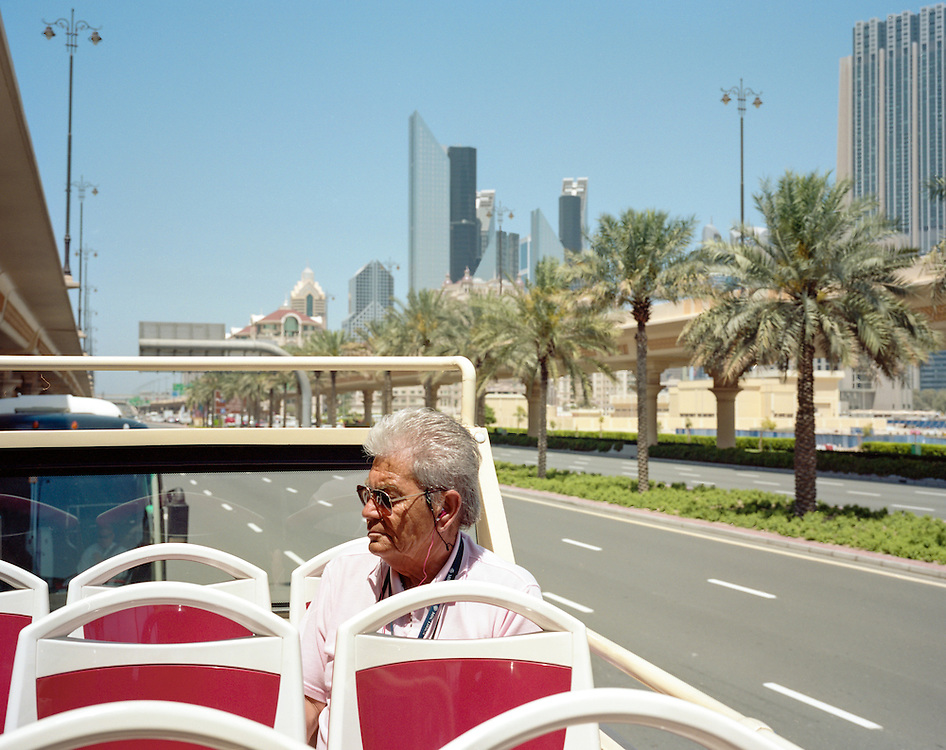 A man in a Touristic Bus in Downtown Dubai