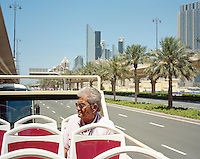 A man in a Touristic Bus in Downtown Dubai