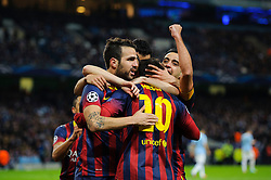 Barcelona Midfielder Lionel Messi (ARG) celebrates with Midfielder Cesc Fabregas (ESP) after scoring a goal from a penalty - Photo mandatory by-line: Rogan Thomson/JMP - Tel: 07966 386802 - 18/02/2014 - SPORT - FOOTBALL - Etihad Stadium, Manchester - Manchester City v Barcelona - UEFA Champions League, Round of 16, First leg.