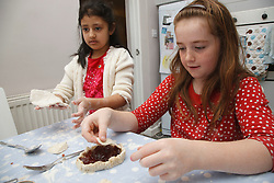 Children making jam tarts