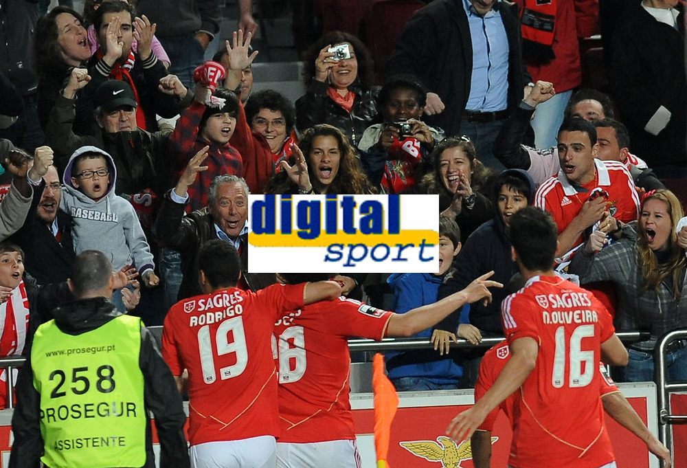 20120331: LISBON, PORTUGAL – Portuguese Liga Zon Sagres 2011/2012 - SL Benfica vs CS Braga.<br />In picture: Benfica's midfielder Axel Witsel, from Belgium, center, celebrates with teammate Rodrigo, from Spain, after scoring the opening goal.<br />PHOTO: Alvaro Isidoro/CITYFILES