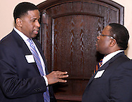 Joey D. Williams of Chase Bank (left) and keynote speaker Christopher Che of Hooven-Dayton during the Dayton Area Chamber of Commerce Breakfast Briefing at the Dayton Racquet Club in downtown Dayton, Friday, January 13, 2012.