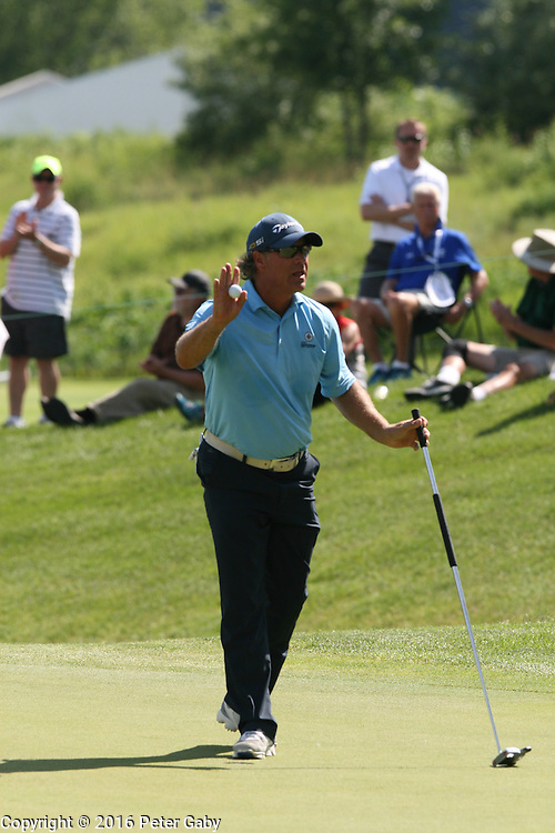 Scott McCarron acknowledges his eagle on the 9th green at the 2016 American Family Championship held at University Ridge Golf Course, Madison,  WI. on June 24, 2016.<br /> <br /> <br /> <br /> <br /> <br /> <br />  2016 American Family Championship held at University Ridge Golf Course, Madison,  WI. on June 23, 2016.