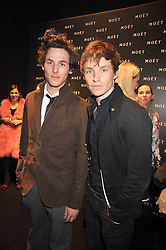 Left to right, brothers TOM REDMAYNE and actor EDDIE REDMAYNE at the Moet & Chandon Tribute to Cinema party held at the Big Sky Studios, Brewery Road, London N7 on 24th March 2009.