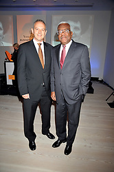 Left to right, GRAHAM BOYES and SIR TREVOR MACDONALD at the presentation of the Veuve Clicquot Business Woman Award 2009 hosted by Graham Boyes MD Moet Hennessy UK and presented by Sir Trevor Macdonald at The Saatchi Gallery, Duke of York's Square, Kings Road, London SW1 on 28th April 2009.