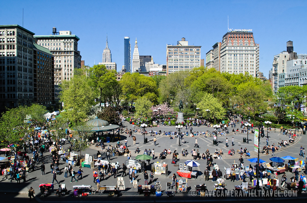 Crowds of people enjoying the warm weather of spring in Union Square, New York City. Elevated view from above looking north.