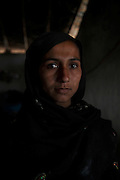 A portrait of Gulbano Babar, age 30, who's whole family enslaved for 14 years for borrowing US$143. <br /> <br /> Following the release of the Global Slavery Index by the Walk Free Foundation Pakistan is ranked 3rd worse in the world behind India and China. The Asian Development Bank estimates some 1.8 million people are slaves in Pakistan yet other estimates reach up to 4 million people, most of which toil year after year in brick kilns or sugar cane plantations. Their stories are the same; they have no-where to turn so they borrow money from a land-owner for a medical emergency or marriage dowry. The landlords pay in return for work, their labour supposed to be taken off the amount borrowed. Yet after years of no salary incredibly their amount owed is often quadrupled, the excuse being the amount they cost to feed! Many are chained, abused, raped and even killed.<br /> <br /> For years they had no where to run, no one to help but now a small local NGO called the Green Development Rural Organisation (GDRO) works to free bonded-slaves by using the law against their captives. Yet, often freed slaves end up right back where they were or risk being hunted by the landowner and forced to return. So GRDO started building villages so slaves who escape or are freed have somewhere safe to go. It now has two, whose names translate from Urdu as 'Village of the Freed' and 'Village of the Courageous', and is working on a 3rd. The land is bought and allocated to freed slave families where they can built a house and start again. Without such help the vicious cycle would continue.